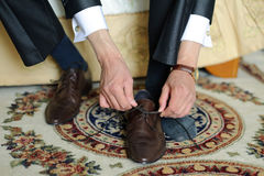 Tying Shoe Strings Royalty Free Stock Images