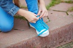 Tying shoelace Stock Image