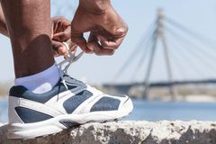 Tying the shoelaces Stock Photos