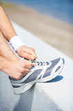 Tying shoelaces. Royalty Free Stock Images