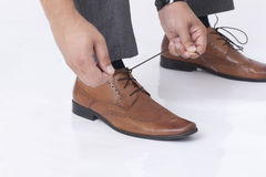 Tying shoelaces Stock Photography