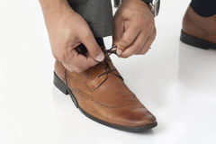 Tying shoelaces Royalty Free Stock Images