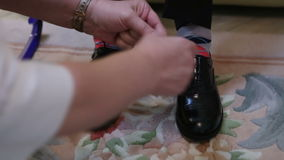 Tying shoelaces teen. Helps tying laces on shoes stock footage