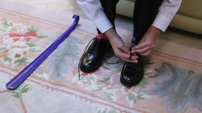 Tying shoelaces teen. Tying the laces on expensive shoes stock footage