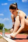 Tying shoelaces before training Stock Photos