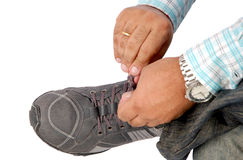 Tying sport shoe laces Royalty Free Stock Images