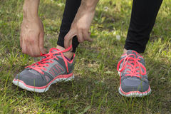 Tying the sport shoes Stock Photography