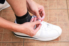 Tying sport shoes prepare running start. Royalty Free Stock Photography