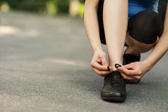 Tying sports shoe Royalty Free Stock Images