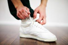 Tying sports shoe Stock Image