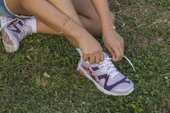 Tying sports shoe. On the grass Royalty Free Stock Photos
