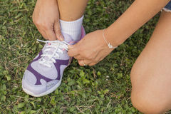 Tying sports shoe. On the grass Stock Photos