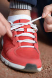 Tying sports shoe Stock Photo