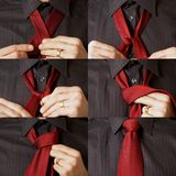 Tying a tie Stock Images