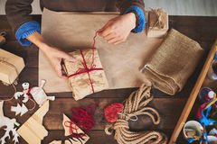 Tying up thread on wrapped present Stock Image