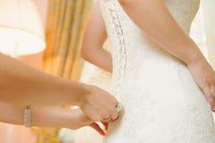 Tying Wedding Corset Stock Images
