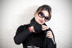 Tying woolen scarf Royalty Free Stock Images