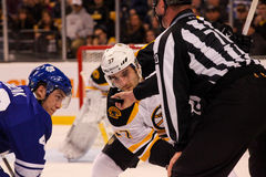 Tyler Bozak and Patrice Bergeron Face-off Royalty Free Stock Photography