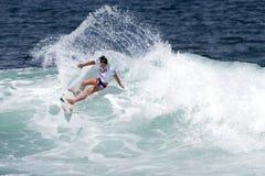 Tyler Wright Surfing in Womens Hawaiian Pro. Tyler Wright from Hawaii Surfing in the Semi final of the Hawaiian Pro Surf Contest.  Part of the 2010 Triple Crown Stock Image