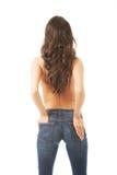 Tylnego widoku bez koszuli kobieta dotyka jej pośladek zdjęcie royalty free