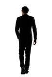 Tylni widok biznesowego mężczyzna spacer Fotografia Stock