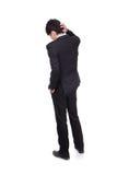Tylni widok młody biznesowy mężczyzna wprawiać w zakłopotanie Fotografia Royalty Free