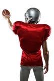 Tylni widok sporta gracz w czerwonej dżersejowej mienie piłce Obrazy Stock