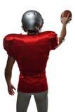 Tylni widok sportowiec w czerwonej dżersejowej mienie piłce Zdjęcie Stock