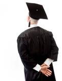 Tylni widok starsza samiec absolwenta pozycja z rękami za b fotografia stock