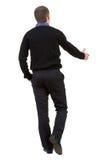 Tylny widok Biznesmen w czarny kostiumu uścisk dłoni Obraz Stock