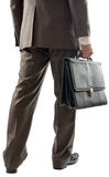 Tylny widok biznesmen z walizką w ręce zdjęcia stock