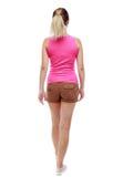 Tylny widok chodząca kobieta piękna blondynki dziewczyna w ruchu Fotografia Stock