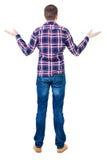 Tylny widok gniewny młody człowiek w cajgach i w kratkę koszula obraz stock