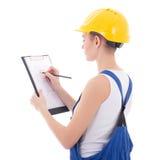 Tylny widok młoda kobieta budowniczego writing coś na budować p Obraz Stock