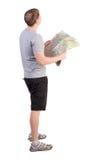 Tylny widok patrzeje mapę podróż młody człowiek Zdjęcia Stock