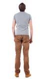 Tylny widok przystojny mężczyzna w koszula i jeanst przyglądający up. Obrazy Stock