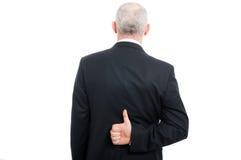 Tylny widok starzejący się elegancki mężczyzna pokazuje jak gest Zdjęcie Stock