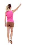 Tylny widok wskazywać chodzącej kobiety Fotografia Royalty Free