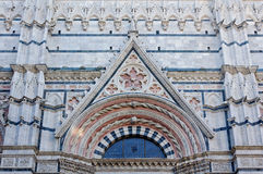 Tympanum of the Baptistery - Siena. The marble tympanum above the entrance of the Baptistery of the Duomo in Siena, Italy Royalty Free Stock Photography