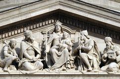 Tympanum bass relief showing the Virgin Mary and Hungarian saints, St. Stephen`s Basilica in Budapest royalty free stock photography