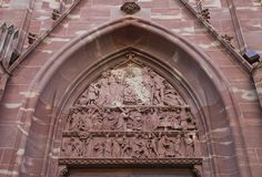 Tympanum of church of Saint-Pierre-le-Vieux in Strasbourg. The tympanum of church of Old Saint Peter (Saint-Pierre-le-Vieux). Shows scenes of life of Apostle Royalty Free Stock Images