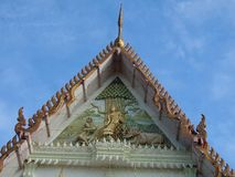 Tympanum and gable of Buddhist temple. Buddha sculpture Folk art  on tympanum of temple of Wat Tung Ladya , Karnchanaburi, Thailand Royalty Free Stock Image