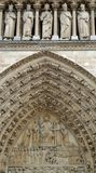 The tympanum of the portal of the Last Judgement at Notre Dame de Paris. Is an example of fine french gothic architecture. This historical cathedral is famous Stock Photo