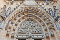 Tympanum of St Vitus Cathedral in Prague. Sculptured tympanum of Metropolitan Cathedral of Saints Vitus, Wenceslaus and Adalbert (founded in 1344) in Prague Royalty Free Stock Image