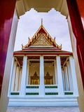 Tympanum with two golden door frames in front of Thai temple. Thai ancient arts Stock Images