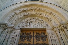 Tympanum or tympan of Basilique Saint-Denis in Paris. Paris,France-January 19,2018:Tympanum or tympan of Basilique Saint-Denis, a Gothic architecture and an Royalty Free Stock Image