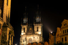 The Tyn Church in the light of lanterns evening in Prague. Royalty Free Stock Photos