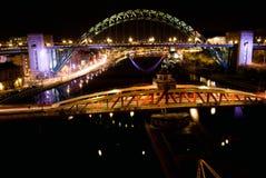 Tyne bridge at night. Tyne arch bridge at night with magic lights, clear black sky, traffic trails, english city, river, Newcastle upon Tyne, England, United Stock Photo