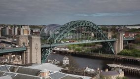 Tyne Bridge Timelapse. A timelapse recording of traffic crossing the Tyne Bridge connecting Newcastle and Gateshead in North East England.  Behind the Tyne stock video footage