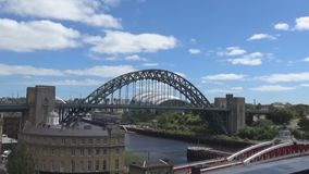 Tyne Bridges 15s. Blue sky, clouds, buildings and two bridges on a river Tyne, Newcastle upon Tyne, UK stock video